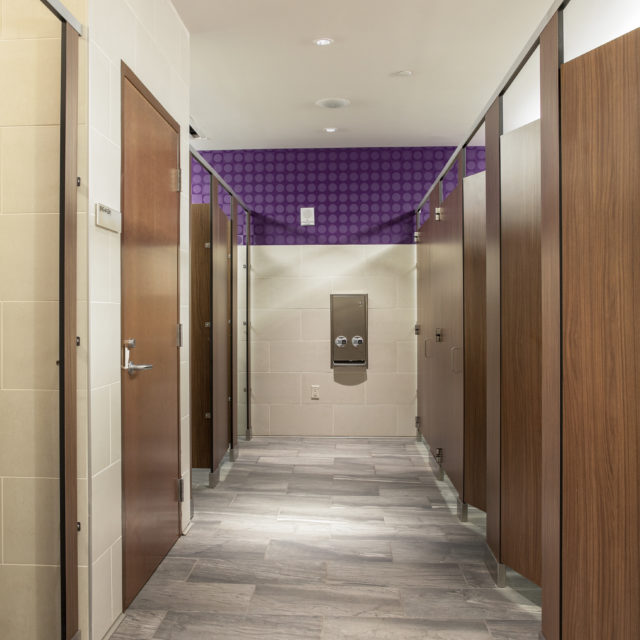 Marble-Inspired Resilient Tile Floors in Women's Restrooms