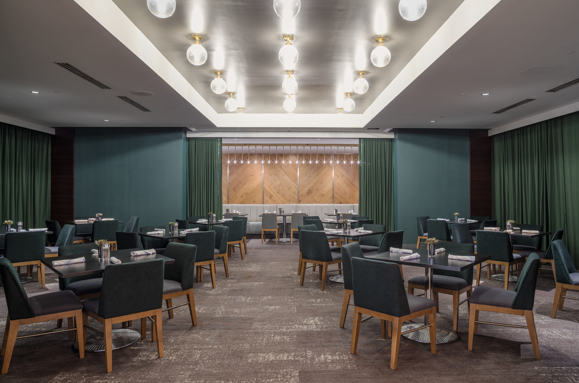 Hotel restaurant features wood-like tile floors