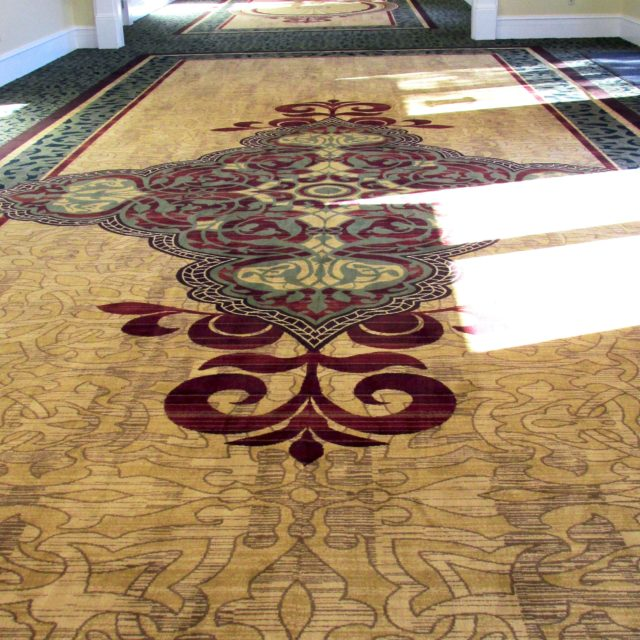 hallway with detailed carpet