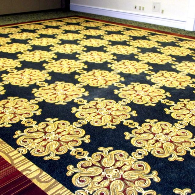Navy and gold carpet in hallway