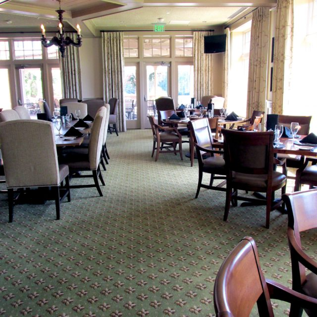 Green patterned carpet in dining area