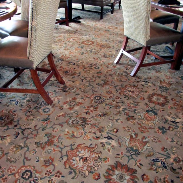 floral carpet covers dining area