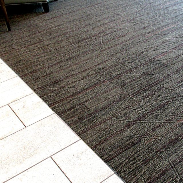 Tile to carpet transition by DCOCF