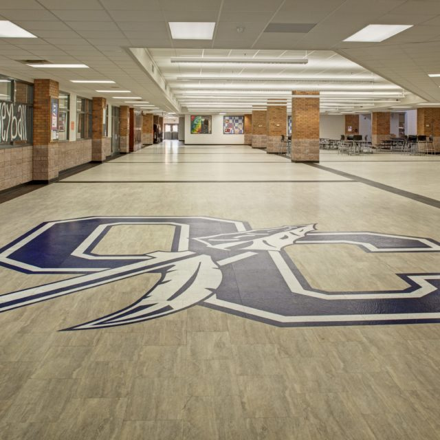 Another version of the Oconee County High School logo in the flooring