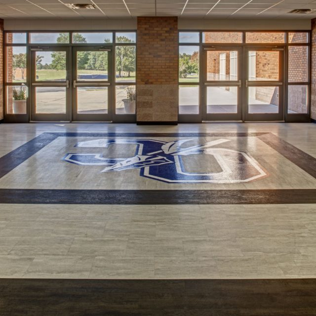 The Oconee County High School logo installed in the flooring by DCOCF in the school lobby