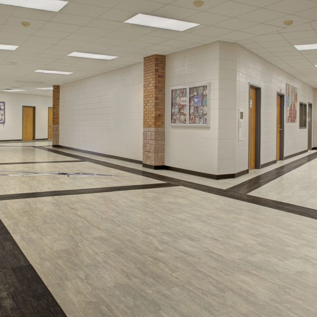 LVP with darker planks framing the halls of Oconee County High School