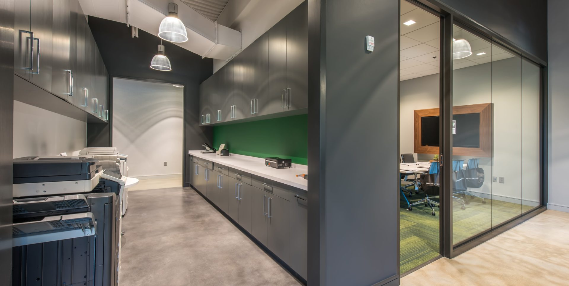 Stone Flooring and Grey Walls in Employee Break Area