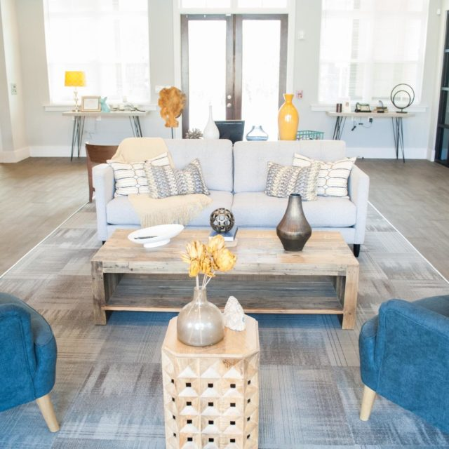 The waiting area at Bellamy Dahlonega sits on a gray striped rug