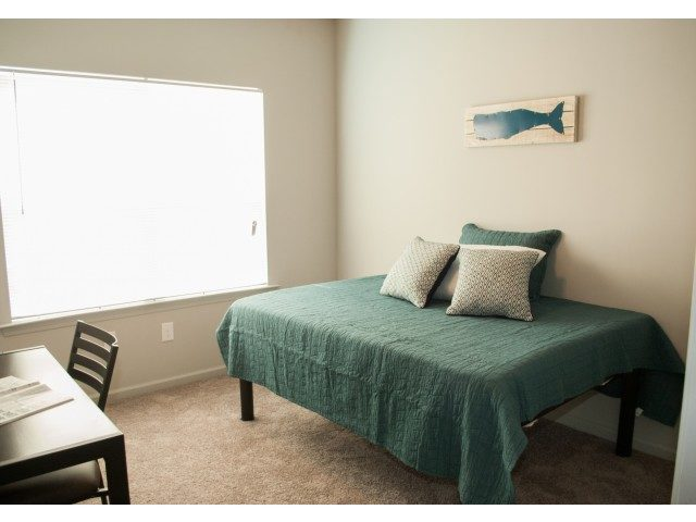 Neutral carpet in the bedroom of a unit at Bellamy Dahlonega
