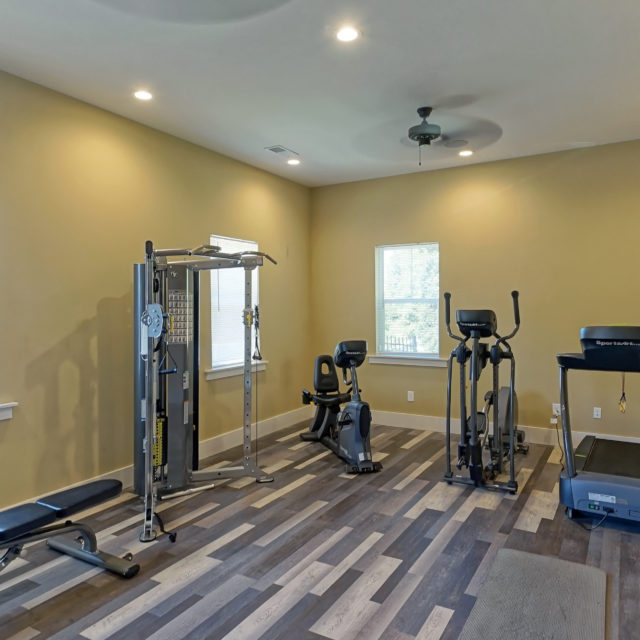 Multi-tonal wood floors make up the fitness center at Bellamy Dahlonega