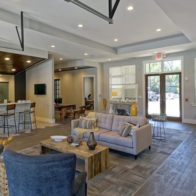 Striped gray rug is sectioned off from wood-like tile at Bellamy Dahlonega