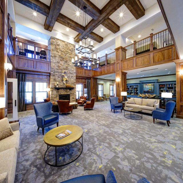 Blue and gray textured carpet make up the entrance of The Glen at Lake Oconee Village