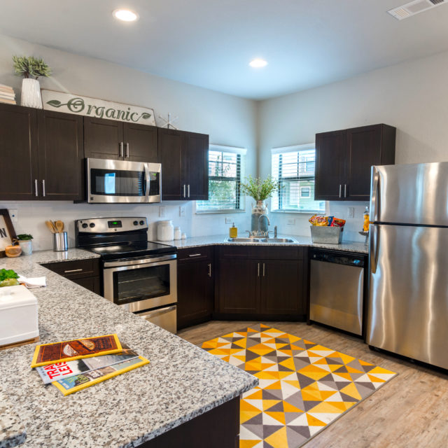 unit kitchen at Aspen Heights - College Station with LVP