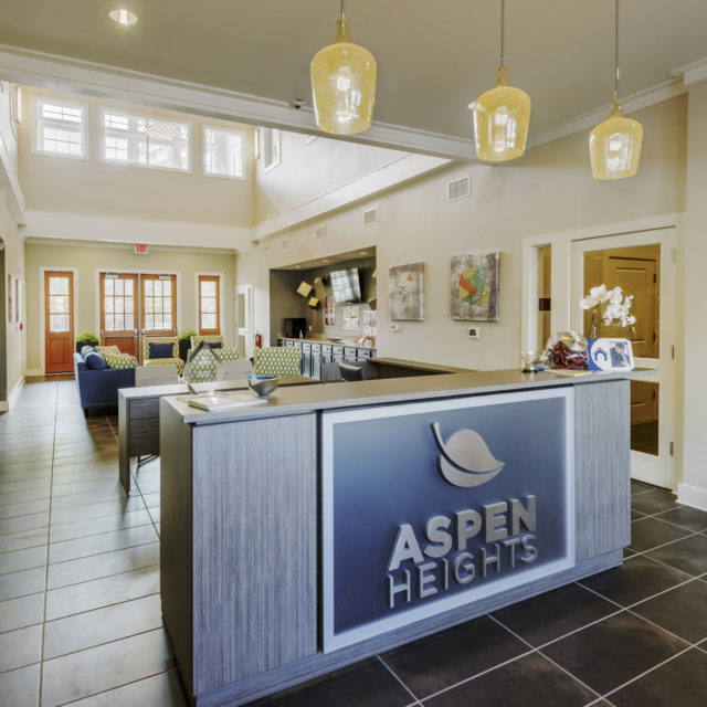 Aspen Heights - Norman front desk with brown tile floors